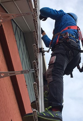 Fixed ladder with rail and fall protection